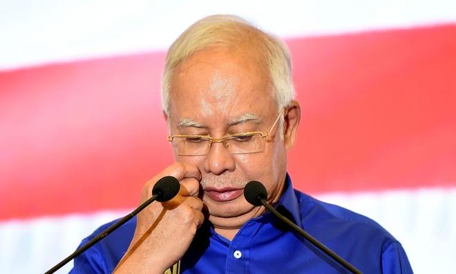 Cuu thu tuong Malaysia doi mat nghi an giet nguoi tinh cua co van hinh anh