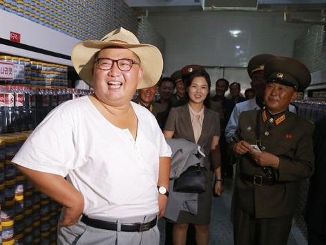 Ong Kim Jong Un va vo tham xuong san xuat ca ngam hinh anh