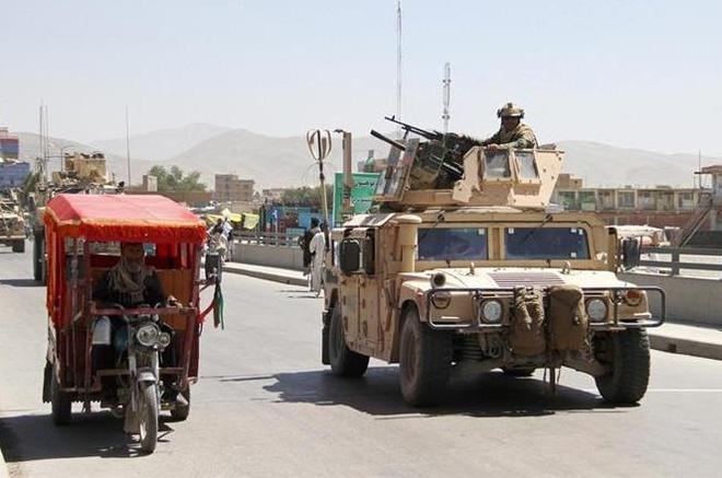 Taliban tai Afghanistan tu choi ngung ban, bat coc them 200 nguoi hinh anh
