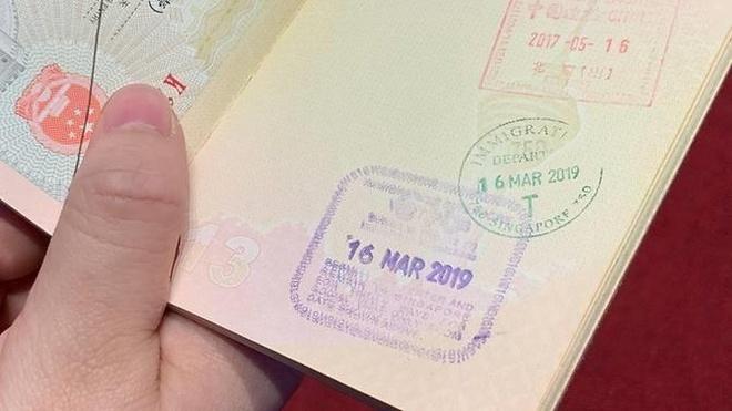 Singapore se ngung dong dau xuat canh tren ho chieu hinh anh 1