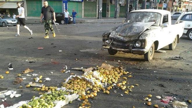 IS danh bom lieu chet tai Syria, 156 nguoi thiet mang hinh anh