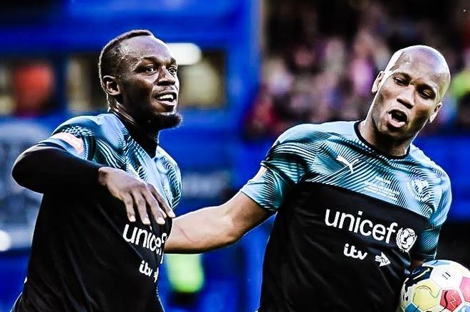 Usain Bolt ghi ban dep mat trong ngay da cap cung Drogba hinh anh