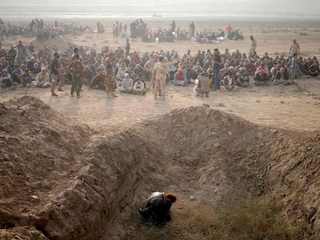Tu binh IS bi linh Iraq nem chet tu tang cao: Hon ca su tra thu hinh anh 1