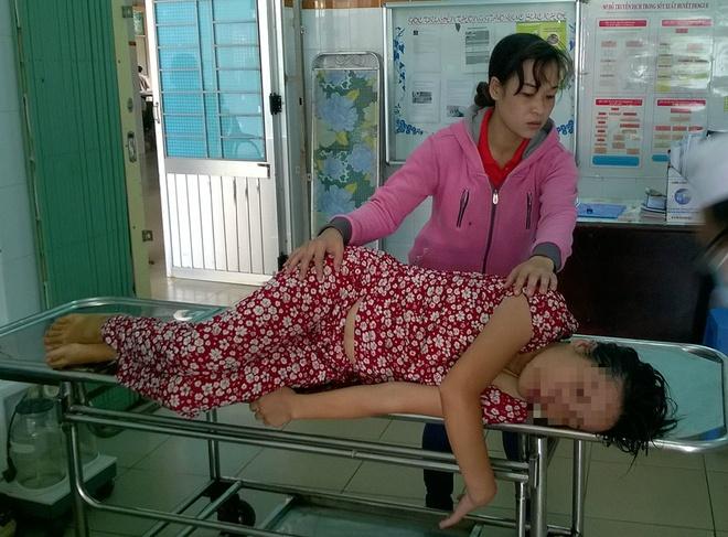 Thai phu uong thuoc tru co sau cuoc cai va voi chong hinh anh 1