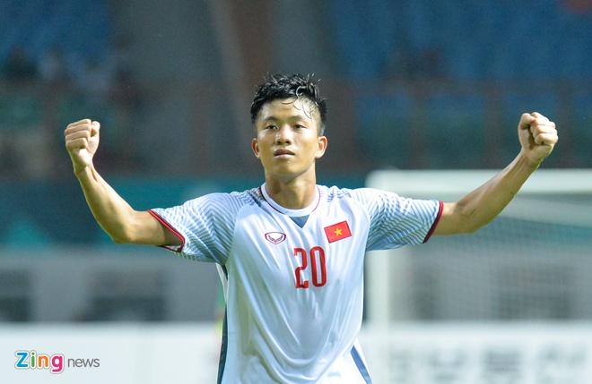 'Song Duc' ghi ban, Olympic Viet Nam vuot qua vong bang ASIAD hinh anh 9