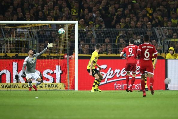 Tiep mach thang hoa, Bayern nhan chim Dortmund tren san khach hinh anh 9