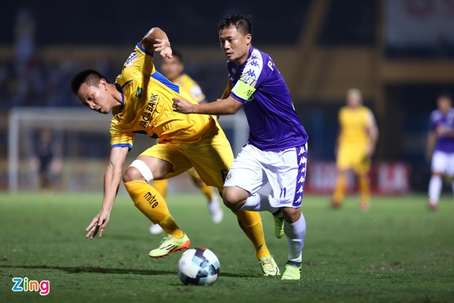 Quang Hai toa sang giup CLB Ha Noi thang dam SLNA 4-0 hinh anh 18
