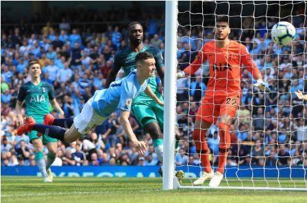 Man City tro lai ngoi dau sau chien thang truoc Tottenham hinh anh 25