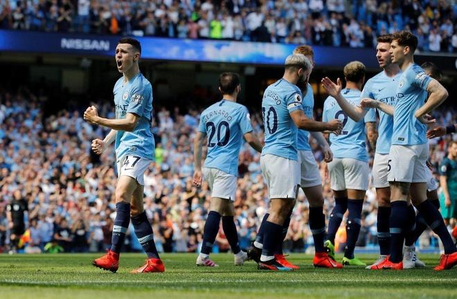 Man City tro lai ngoi dau sau chien thang truoc Tottenham hinh anh 27