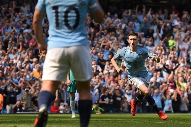 Man City tro lai ngoi dau sau chien thang truoc Tottenham hinh anh 26