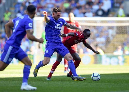 Liverpool tro lai ngoi dau sau chien thang truoc Cardiff City hinh anh 19