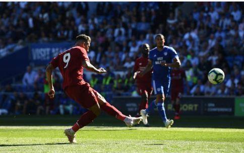 Liverpool tro lai ngoi dau sau chien thang truoc Cardiff City hinh anh 21