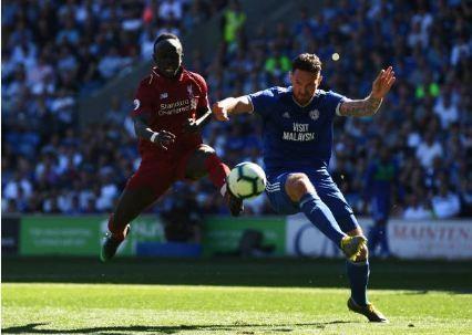 Liverpool tro lai ngoi dau sau chien thang truoc Cardiff City hinh anh 22