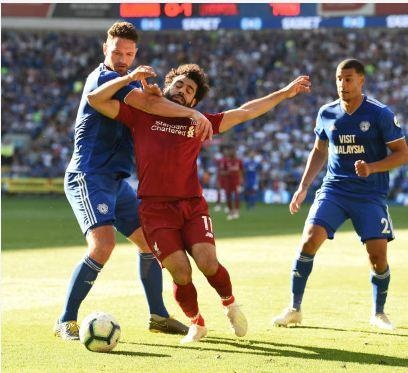 Liverpool tro lai ngoi dau sau chien thang truoc Cardiff City hinh anh 33