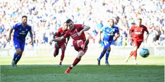 Liverpool tro lai ngoi dau sau chien thang truoc Cardiff City hinh anh 36