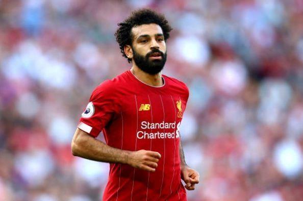 Salah lap cu dup giup Liverpool thang cach biet Arsenal hinh anh 25