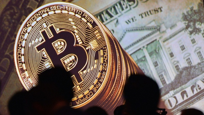 Bitcoin xuong nguong 7.000 USD, thi truong tien ao bay hoi 100 ty USD hinh anh 1