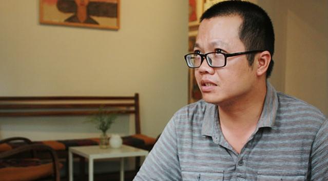 Uong Trieu: Nha van nghien sach hinh anh
