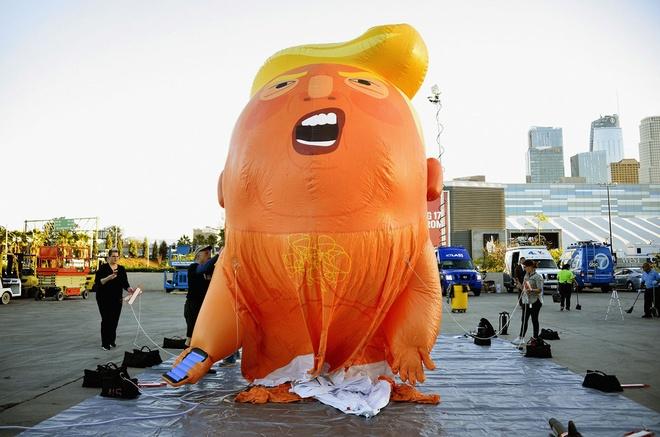 'Baby Trump' va dong nguoi di cu Honduras vao top anh tuan hinh anh