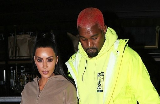 Vo chong Kim Kardashian bi chi trich vi thue may bay lon, gay o nhiem hinh anh