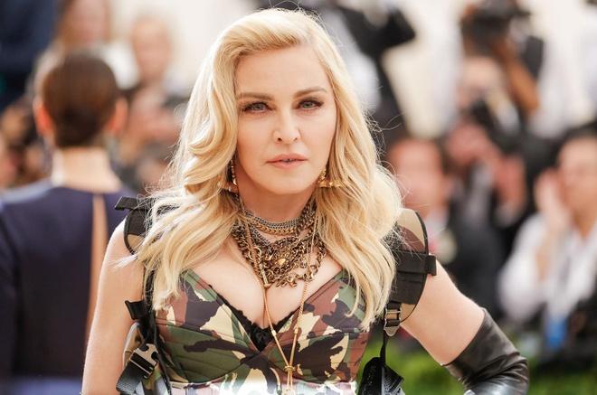 Madonna, Justin Bieber lot top 20 ca si giau nhat the gioi hinh anh 1