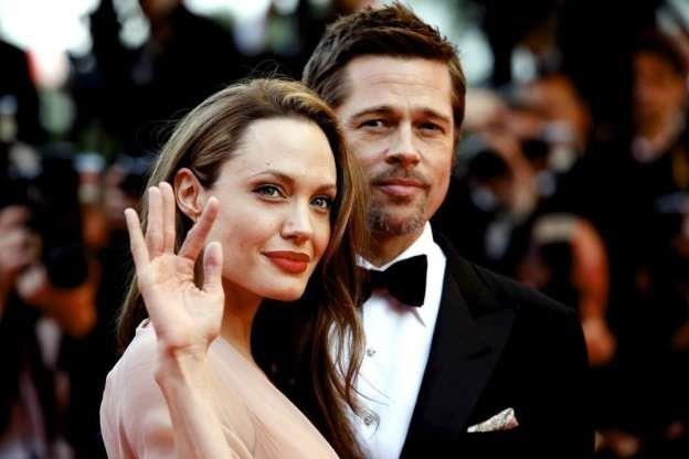 Angelina Jolie, Brad Pitt chinh thuc thanh nguoi doc than hinh anh 1
