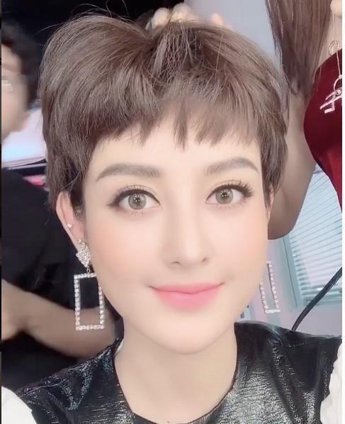 Bao Anh cat toc tem ca tinh sau on ao yeu lai Ho Quang Hieu hinh anh 7