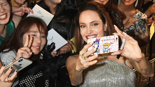 Angelina Jolie hoi ngo Maddox anh 8