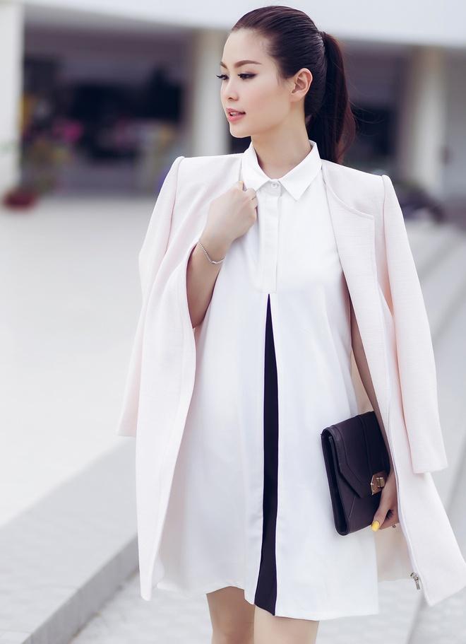A hau Diem Trang goi cam voi 6 trang phuc duong pho hinh anh 5