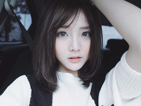 Hot girl Thai Lan mac ao dai cover 'Ly cay bong' hinh anh