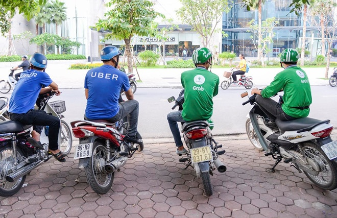 Thuong vu Grab mua Uber co dau hieu vi pham phap luat hinh anh