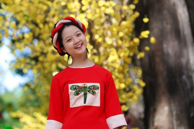 Sao nhi Lam Thanh My dien ao dai xuong pho hinh anh 6