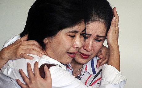 Hai thi the nan nhan QZ8501 ve dat lien hinh anh 3