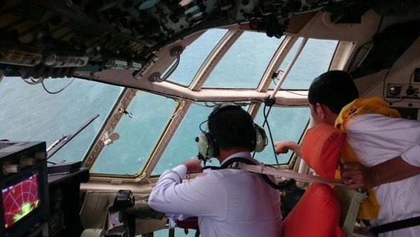 Hai thi the nan nhan QZ8501 ve dat lien hinh anh 7