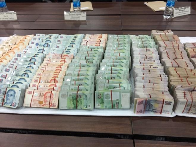 Hai nguoi Viet bi bat vi trom gan 350.000 USD o Singapore hinh anh