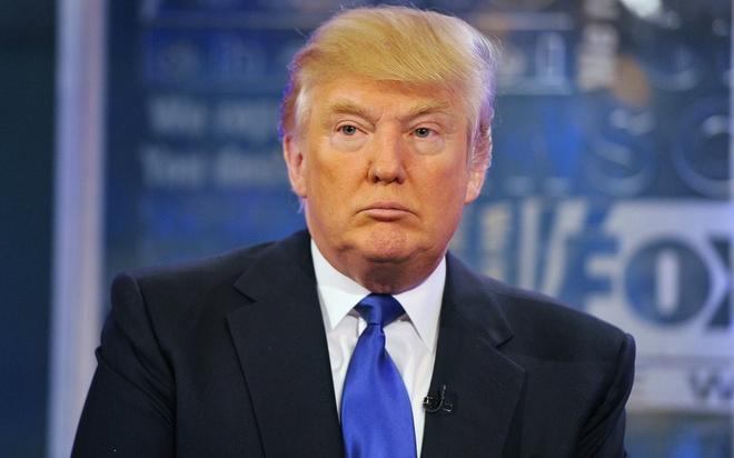 Forbes: Tong thong Donald Trump mat 1 ty USD, tut 220 bac sau mot nam hinh anh 1