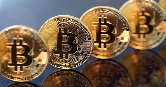 Bitcoin dang tien den muc gia 10.000 USD mot don vi hinh anh