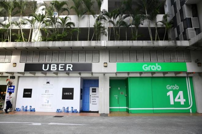 Uber Dong Nam A se cong bo ban minh cho Grab hom nay? hinh anh 1