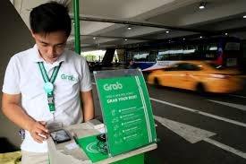 Philippines yeu cau hoan vu sap nhap Uber vao Grab vo thoi han hinh anh