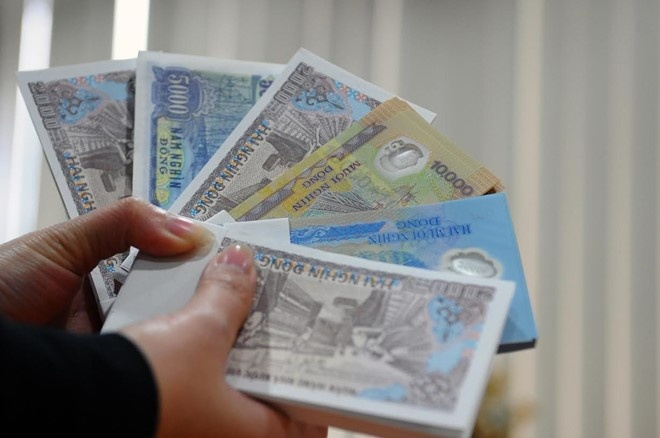Trước Tết 2 tháng, dịch vụ đổi tiền mới đã nở rộ chợ mạng - Ảnh 1