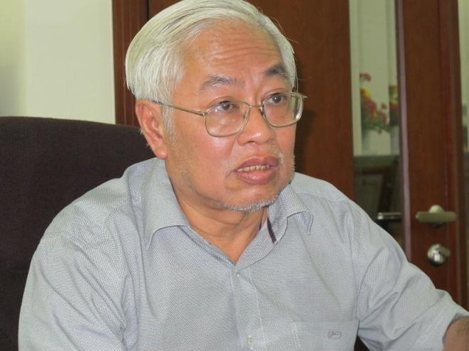 Nguyen TGD DongA Bank Tran Phuong Binh cui dau nhan loi hinh anh 1