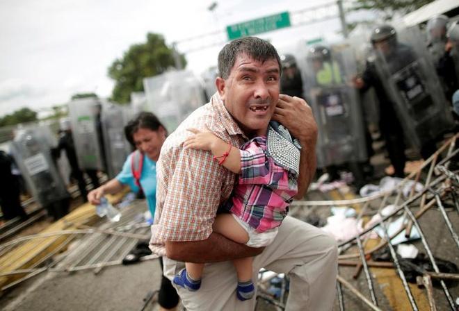 3.000 nguoi Honduras di bo xuyen Trung My tim giac mo doi doi hinh anh