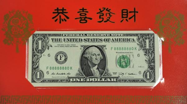 25.000 dong to 100 USD vang gia li xi Tet hinh anh