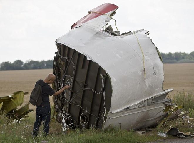 Cong bo bao cao dau tien ve tham hoa MH17 hinh anh