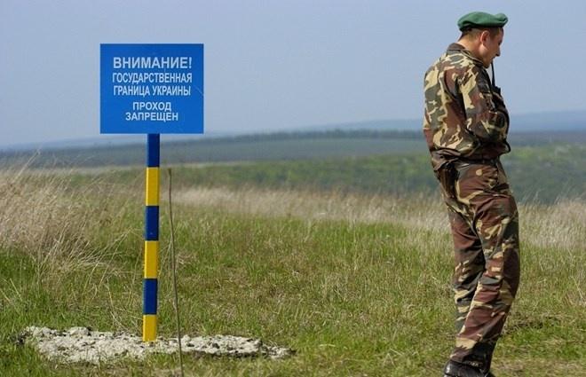 Ukraine bat dau xay dung 'buc tuong bien gioi' voi Nga hinh anh