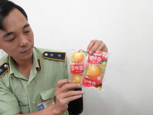 Long leo quan ly trai cay ngoai hinh anh 2 Nước ép trái lê Hàn Quốc không rõ chất lượng.