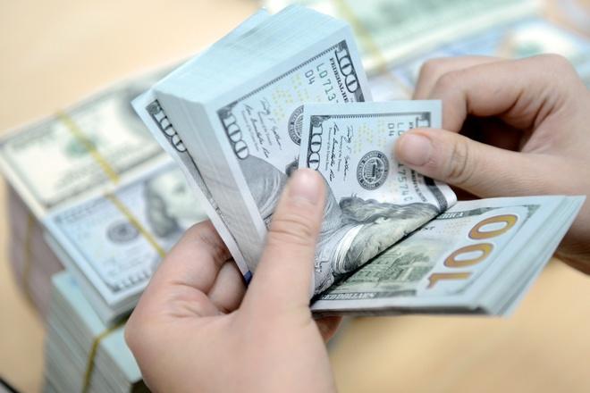 Vi sao gia ban USD tang sat 21.600 dong? hinh anh