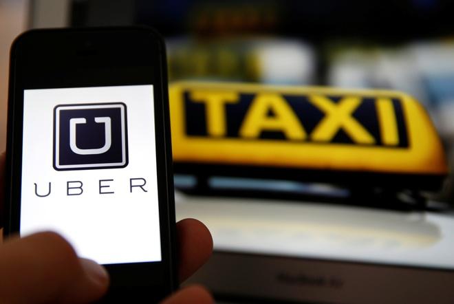 Uber tang gia gap 5 lan trong ngay mua ngap o Sai Gon hinh anh