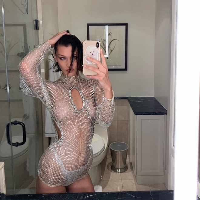 Kim Kardashian va dan sao thich dien vay xuyen thau khoe body goi cam hinh anh 4 80803720_1444414379066536_7225819650913029918_n.jpg