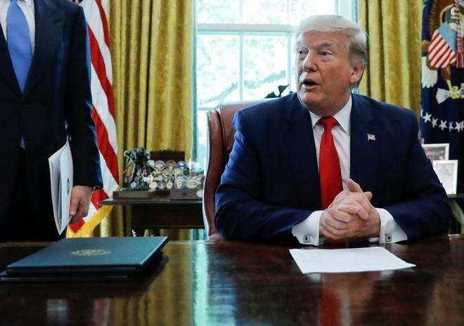 TT Trump: Iran 'dua voi lua' khi lam giau uranium vuot muc quy dinh hinh anh 1